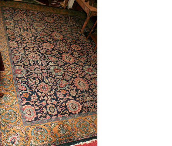 A large Tabriz carpet 350cm x 430cm.
