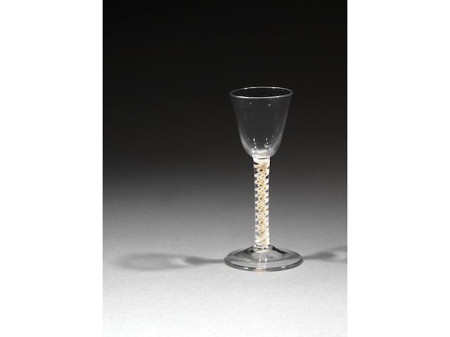 A rare yellow colour-twist wine glass circa 1770
