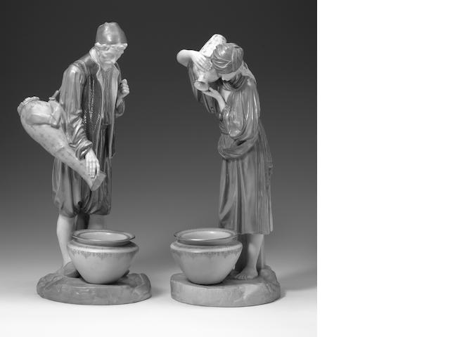 A pair of Royal Worcester figures of Eastern Water carriers  dated 1906