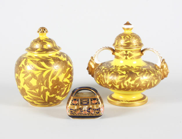 Two Derby Crown Porcelain Co vases and covers and a Royal Crown Derby miniature basket Early 20th Century