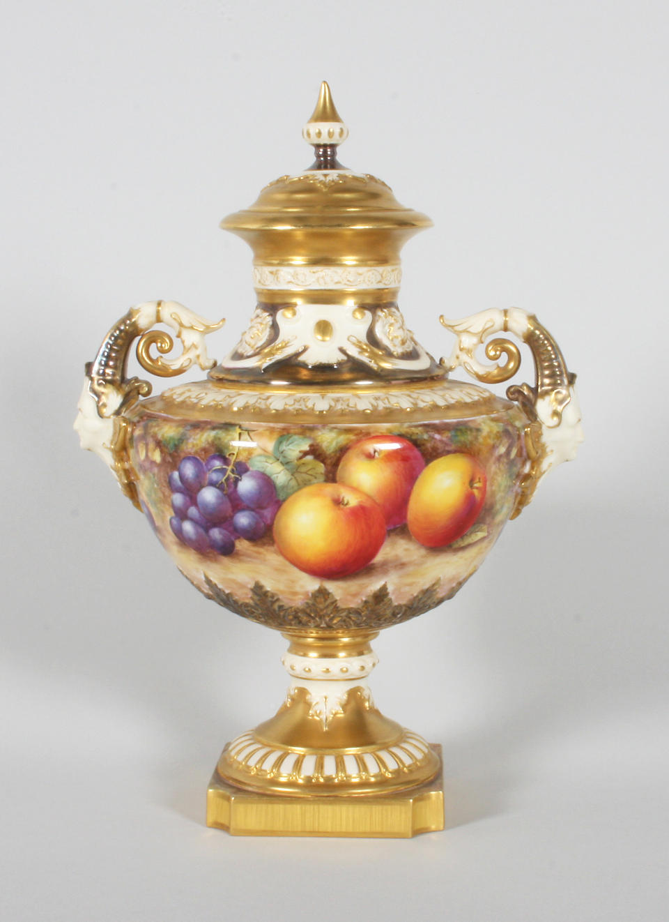 A Royal Worcester fruit painted twin handled vase and cover by John Freeman