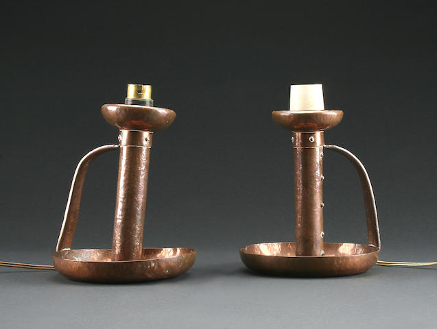 A pair of Arts and Crafts hammered copper chamber candlesticks, circa 1910,
