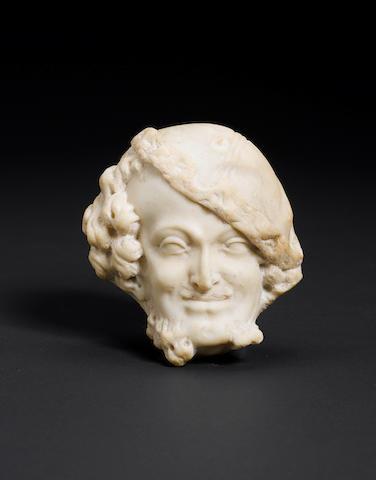 Workshop of Orazio Marinali, Italian (1643-1720) A carved white marble grotesque head