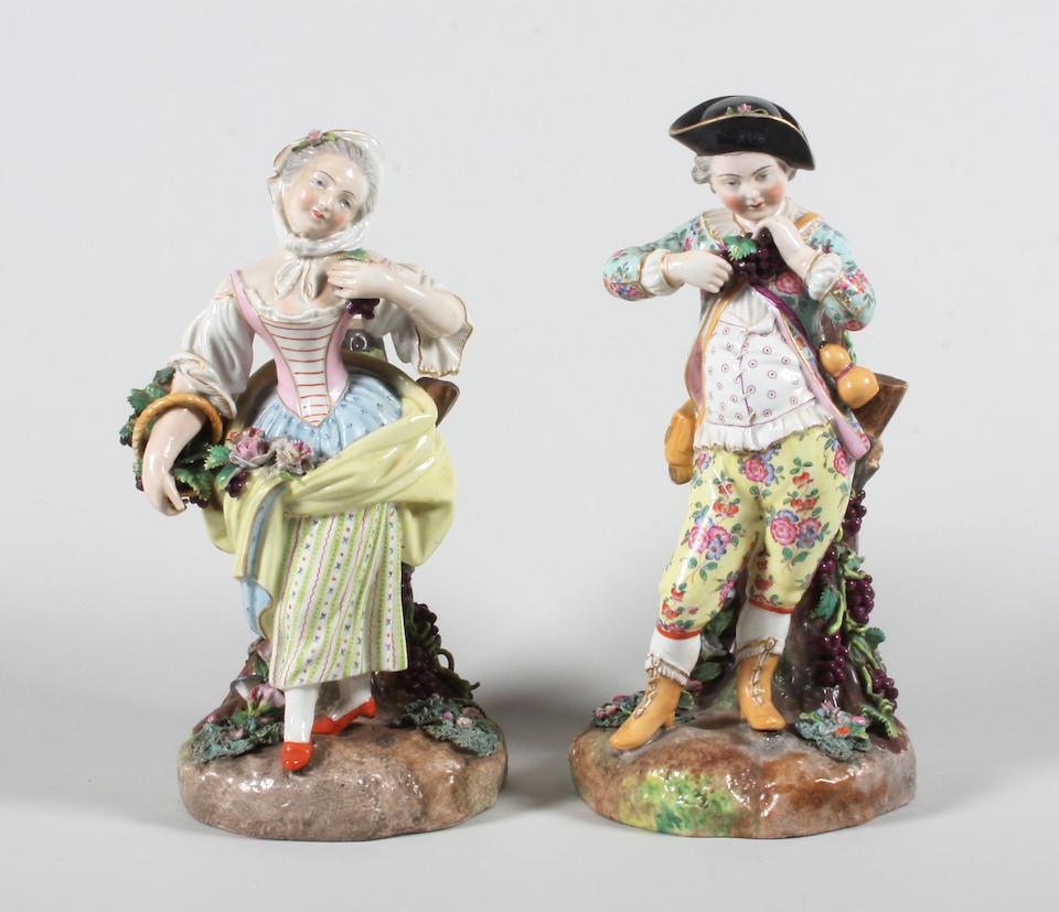 A Porcelain de Paris large clock case and a pair of figures