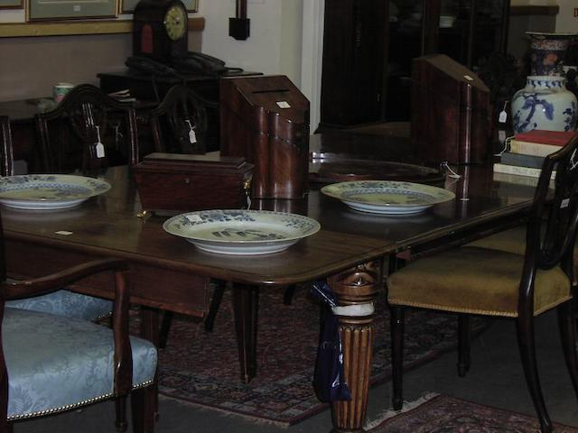 A William IV or early Victorian mahogany dining table