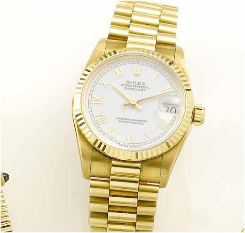Rolex. A lady's 18ct gold centre seconds calendar bracelet watch Datejust, 2000