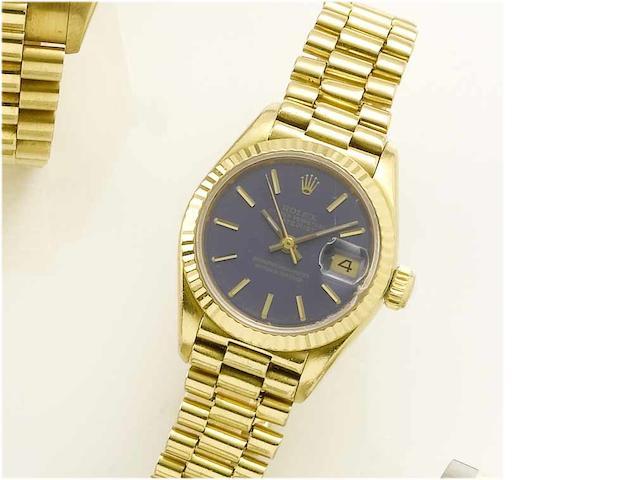 Rolex. A lady's 18ct gold centre seconds calendar bracelet watch Datejust, 1985