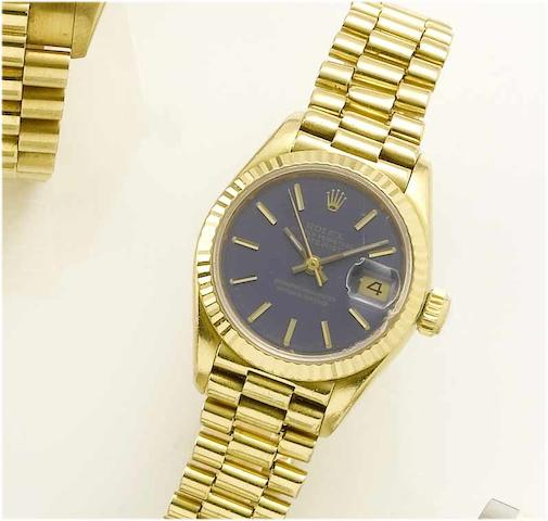 Rolex. A lady's 18ct gold centre seconds calendar bracelet watch Datejust, 1985