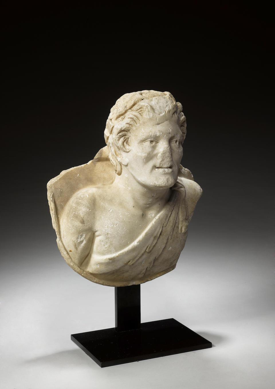 A Roman marble bust of a satyr