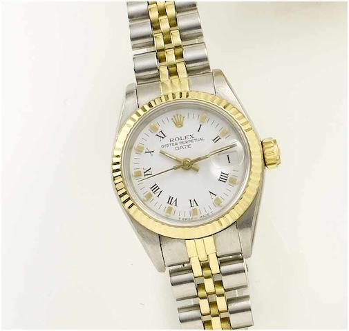 Rolex. A lady's stainless steel and gold centre seconds calendar bracelet watch  Oyster Date, 1984