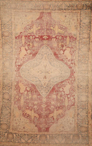 A very faded silk Persian hanging carpet