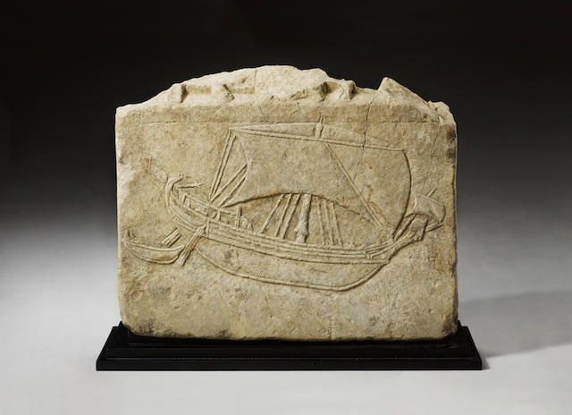A Roman marble relief of a merchant ship