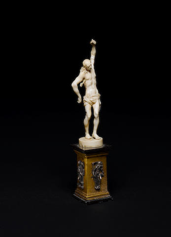 A 17th century German carved miniature ivory figure of Saint Sebastian