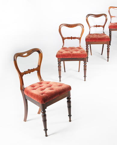 A set of nine Edwardian rosewood dining chairs
