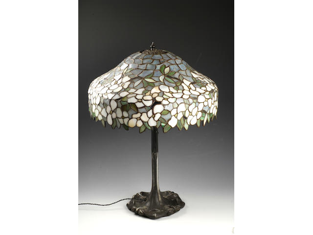 An American table lamp in the Tiffany 'dogwood' style circa 1910