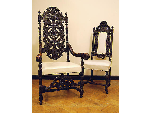 A set of ten late Victorian carved oak dining chairs