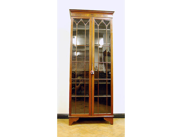 A mahogany and inlaid standing glazed bookcase, late 19th Century