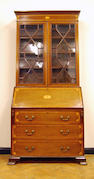 An Edwardian mahogany and satinwood-banded bureau bookcase