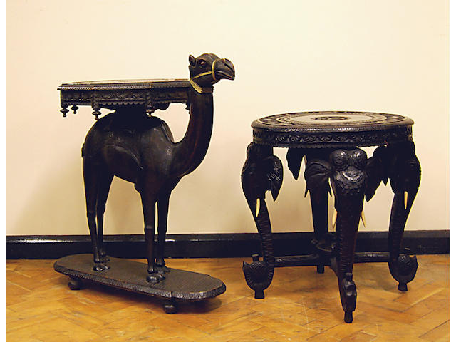 An Indian carved hardwood occasional table in the form of a camel
