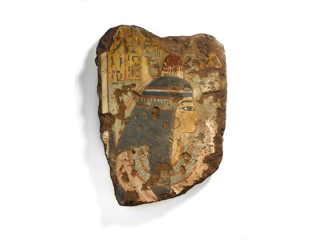 An Egyptian polychrome painted wall fragment