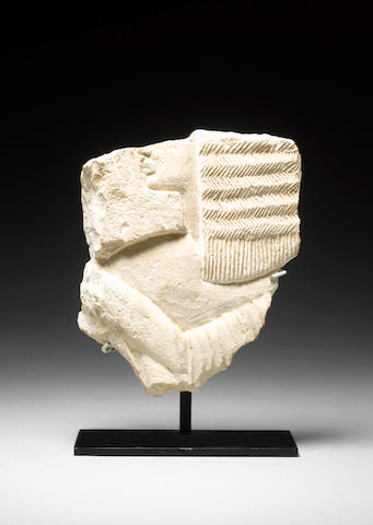 An Egyptian limestone relief fragment of an official