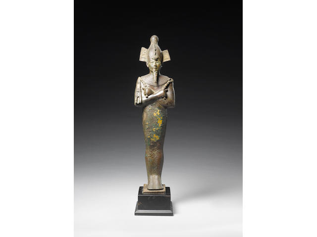 A large Egyptian bronze figure of Osiris