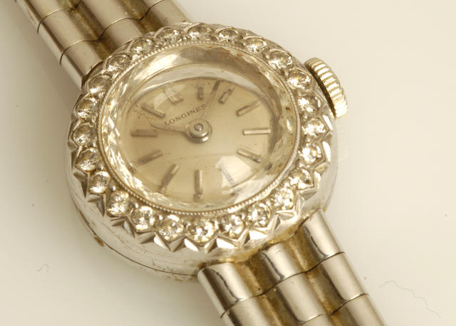 A lady's 18ct white gold and diamond wristwatch, by Longines