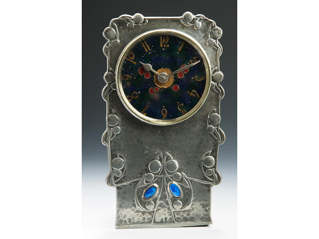 A Liberty & C0. A Tudric Pewter time piece, designed by Archibald Knox
