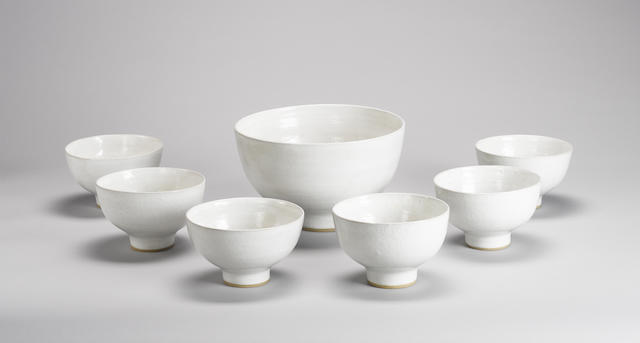 Dame Lucie Rie a set of six soup Bowls and a Tureen, circa 1958 Diameter of Tureen 22.5cm (8 7/8in.) Diameter of Bowls 13.5cm (5 3/8in.)
