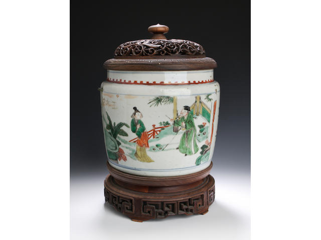 A famille verte jar with hardwood cover and stand 18th century