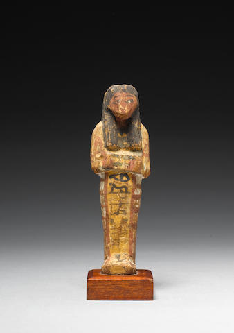 An Egyptian polychrome painted wood shabti