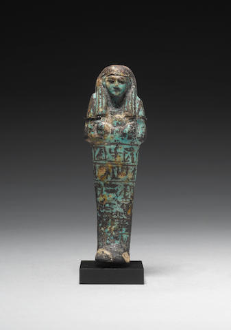 An Egyptian blue and black glazed composition shabti