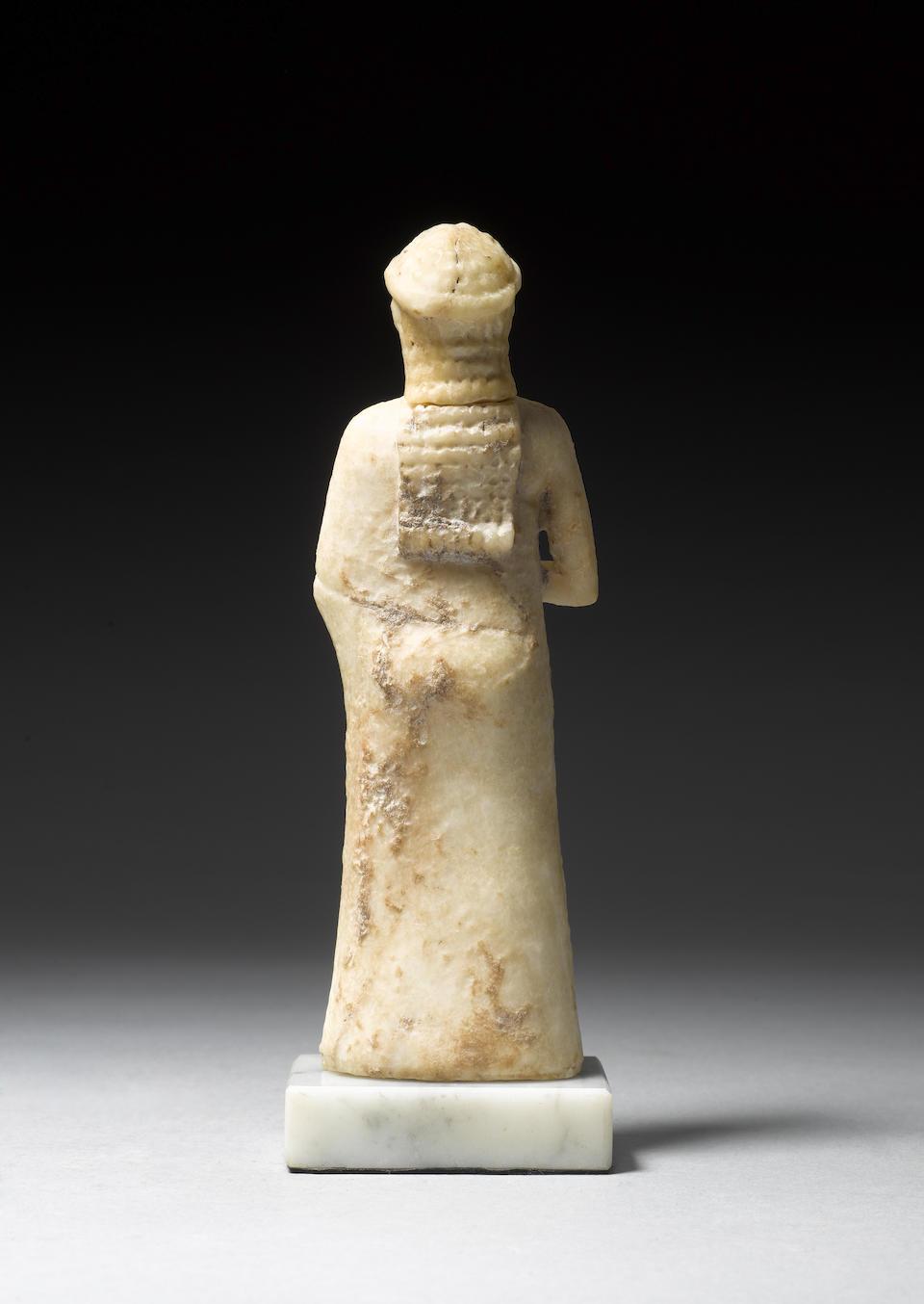A Mesopotamian limestone female figure