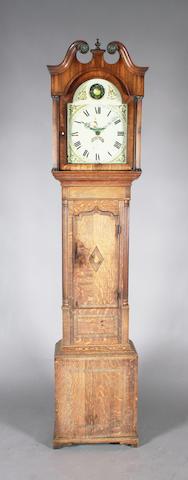 An early 19th century oak and mahogany longcase clock