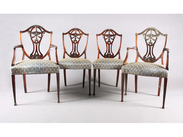 A set of twelve Adam revival carved mahogany dining chairs, circa 1900