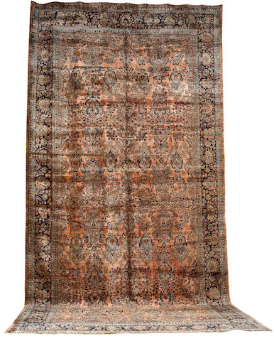 A large Sarouk carpet West Persia, 23 ft 11 in x 11 ft 11 in (739 x 363 cm)