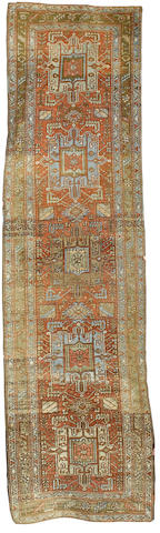 An Heriz runner North West Persia, 10 ft 11 in x 3 ft (334 x 92 cm)