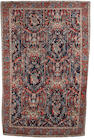 A North West Persian carpet 11 ft x 7 ft 4 in (336 x 223 cm)worn