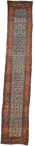 A Bidjar runner Persian Kurdistan, 17 ft 3 in x 3 ft 3 in (526 x 100 cm)minor restoration