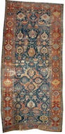 A 17th century South Caucasian long rug possibly Karabagh area,  12 ft 9 in x 6 ft 2 in (388 x 188 cm)worn and some restoration