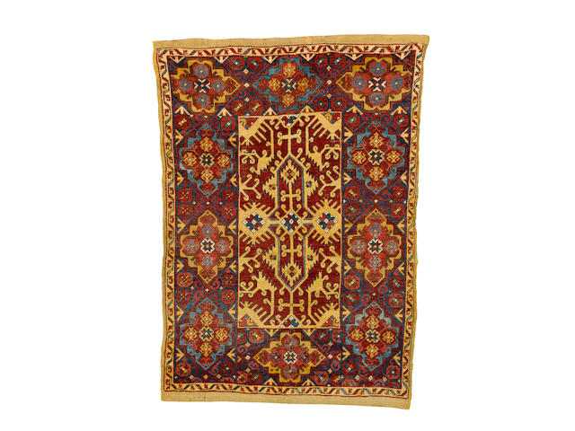 An Ushak rug of Lotto design West Anatolia, late 18th century 5 ft 6 in x 3 ft 10 in (168 x 117 cm ) restorations