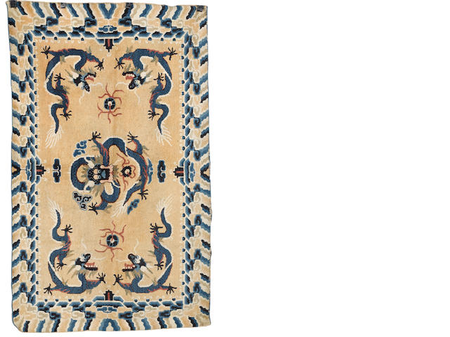 A Chinese rug 6 ft 7 in x 4 ft (201 x 122 cm) some minor losses