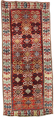 A Caucasian rug 9 ft 1 in x 3 ft 10 in (276 x 118 cm)