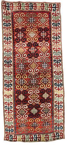 A Caucasian rug 9 ft 1 in x 3 ft 10 in (276 x 118 cm)