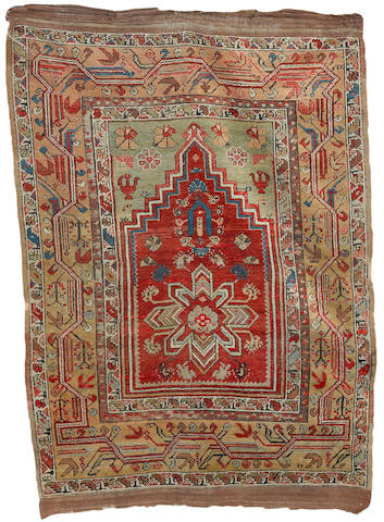 An Anatolian prayer rug 4 ft 11 in x 3 ft 7 in (150 x 109 cm)