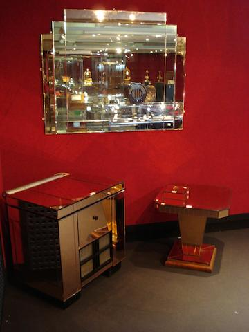 HMV:  A peach and white mirror-clad matched study suite, in the Art-Deco taste, circa 1936,