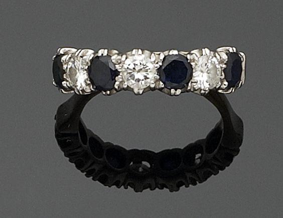 A sapphire and diamond seven-stone ring