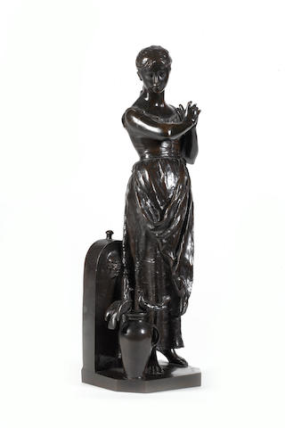 Alfred Boucher (French, 1850-1934): A late 19th century bronze figural group of a girl with an urn and a pair of doves
