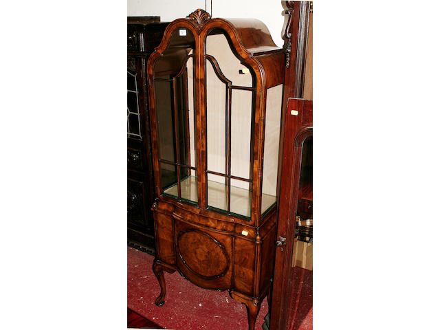 A Queen Anne style walnut display cabinet