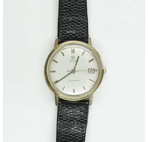 Omega, Seamaster: A gentleman's gold calendar wristwatch,